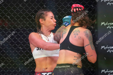 Sarah Click hits Kristi Lopez with a hook during a mixed martial arts bout at Bellator 207, in Uncasville, CT, on . Click won via decision