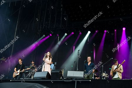 Lauren Mayberry Natt Berninger Aaron Dessner Bryce Dessner Scott Devendorf. Lauren Mayberry of Chvrches performs with Aaron Dessner, from left, Bryce Dessner, Matt Berninger, and Scott Devendorf of The National on day one of the Austin City Limits Music Festival's second weekend, in Austin, Texas