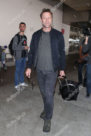 Editorial picture of Aaron Eckhart at LAX International Airport, Los Angeles, USA - 12 Oct 2018