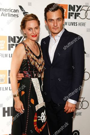 """Aimee Mullins, Rupert Friend. Aimee Mullins, left, and Rupert Friend, right, attend the closing night gala premiere of """"At Eternity's Gate"""" during the 56th New York Film Festival at Alice Tully Hall, in New York"""