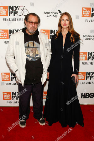 """Julian Schnabel, May Andersen. Julian Schnabel, left, and May Andersen, right, attend the closing night gala premiere of """"At Eternity's Gate"""" during the 56th New York Film Festival at Alice Tully Hall, in New York"""