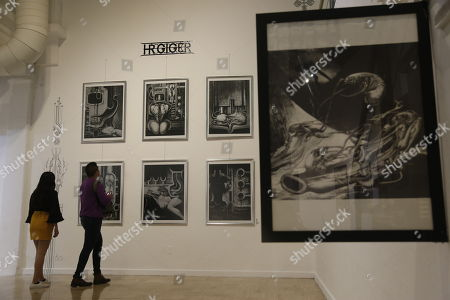People view the exhibition 'Escena Obscura' by Swiss artist Hans Ruedi Giger exhibited at the University of Guanajuato during the XLVI International Cervantino Festival (FIC) that takes place in the city of Guanajuato, Mexico, 12 October 2018.