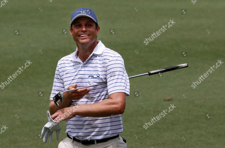 Nick Watney of the USA smiles after sinking a putt during the third round of the 2018 CIMB Classic Golf PGA Tour tournament, in Kuala Lumpur, Malaysia, 13 October 2018.