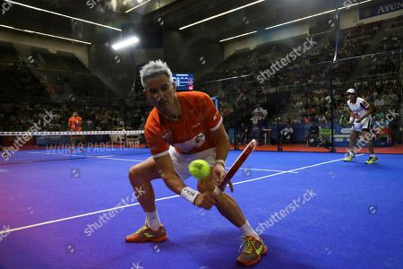 Argentinian paddle tennis player Miguel Lamperti in action during the semifinal match against Argentinians Sanyo Gutierrez (unseen) and Maxi Rodriguez (unseen) at the Granada Open of the World Padel Tour held in Granada, Spain, 13 October 2018.