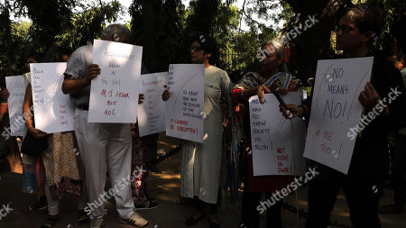 Indian journalists hold placards during a protest against incidents of sexual assault and harassment at work place, in New Delhi, India, 13 October 2018. According to reports, Bollywood actress Tanushree Dutta filed complaint of sexual harassment against actor Nana Patekar. Indian Journalists show their support MeToo movement where women sharing incidents of sexual assault and harassment.