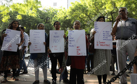 Stock Photo of Indian journalists hold placards during a protest against incidents of sexual assault and harassment at work place, in New Delhi, India, 13 October 2018. According to reports, Bollywood actress Tanushree Dutta filed complaint of sexual harassment against actor Nana Patekar. Indian Journalists show their support MeToo movement where women sharing incidents of sexual assault and harassment.