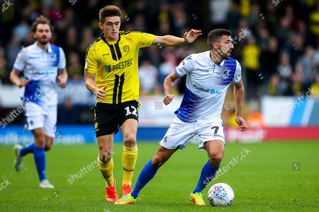 Liam Sercombe of Bristol Rovers takes on Ben Fox of Burton Albion