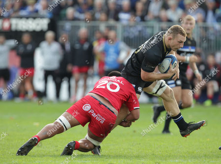 Stock Picture of Sam Underwood of Bath ia tackled by Selevasio Tolofua of Toulouse