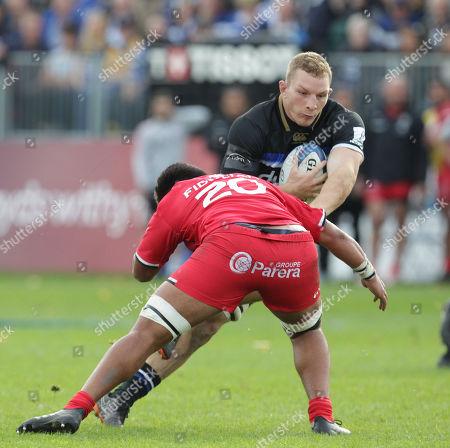 Sam Underwood of Bath ia tackled by Selevasio Tolofua of Toulouse