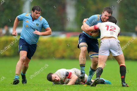 Dublin University vs UCD. UCD's Ronan Foley is tackled by Phil Murphy of Dublin University