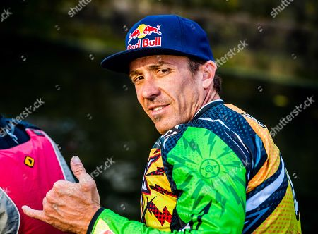 Australian stunt rider Robbie Maddison gestures after riding his dirt bike over the water of a canal in The Hague, The Netherlands, 13 October 2018. The motocross rider made the stunt in the lead up to the Red Bull Knock Out on 10 November in Scheveningen, The Netherlands.