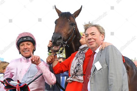 TOO DARN HOT ridden by Frankie Dettori with Lord Lloyd Webber after winning The Darley Dewhurst Stakes (Group 1) at Newmarket