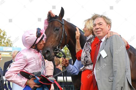 TOO DARN HOT ridden by Frankie Dettori with Lord and Lady Lloyd Webber after winning The Darley Dewhurst Stakes (Group 1) at Newmarket