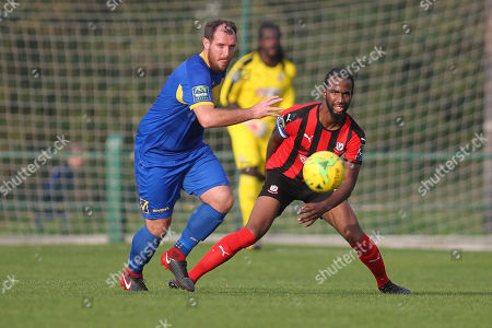 Stock Picture of Nick Reynolds of Romford and Dexter Peter of Coggeshall during Romford vs Coggeshall Town, Bostik League Division 1 North Football at Rookery Hill on 13th October 2018