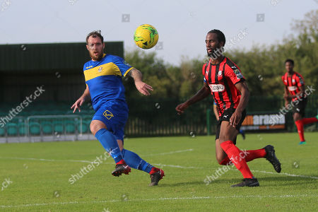Stock Photo of Dexter Peter of Coggeshall and Nick Reynolds of Romford during Romford vs Coggeshall Town, Bostik League Division 1 North Football at Rookery Hill on 13th October 2018