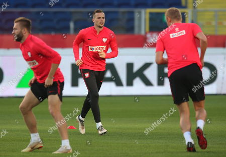 Polish national soccer team players Jakub Blaszczykowski (L) and Tomasz Kedziora (C) warms up during their team's training session in Chorzow, Poland, 13 October 2018. Poland will face Italy in their UEFA Nations League soccer match on 14 October in Chorzow, Poland.