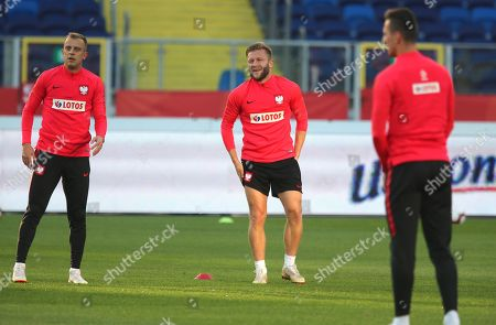 Polish national soccer team players Jakub Blaszczykowski (L) and Kamil Glik (2-L) warms up during their team's training session in Chorzow, Poland, 13 October 2018. Poland will face Italy in their UEFA Nations League soccer match on 14 October in Chorzow, Poland.