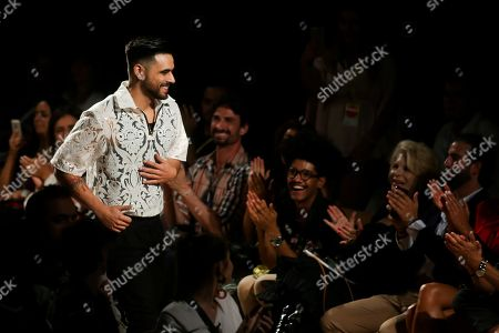 Stock Picture of Fashion designer Patrick de Padua acknowledges the crowd at the end of his runway show on the third day of the 51st Lisbon Fashion Week at Carlos Lopes Pavillion in Lisbon, Portugal, 13 October 2018. The event runs untill 14 October.