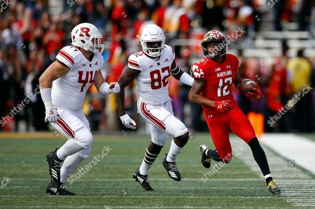 Max Anthony, Taivon Jacobs, Zihir Lacewell. Maryland punt returner Taivon Jacobs, right, rushes past Rutgers defenders Max Anthony, left, and Zihir Lacewell in the first half of an NCAA college football game, in College Park, Md
