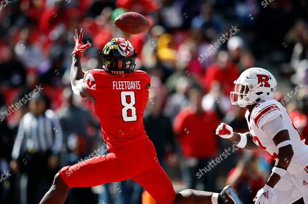Stock Image of Damon Hayes, Tayon Fleet-Davis. Maryland running back Tayon Fleet-Davis, left, catches a pass for a touchdown in front of Rutgers defensive back Damon Hayes in the first half of an NCAA college football game, in College Park, Md