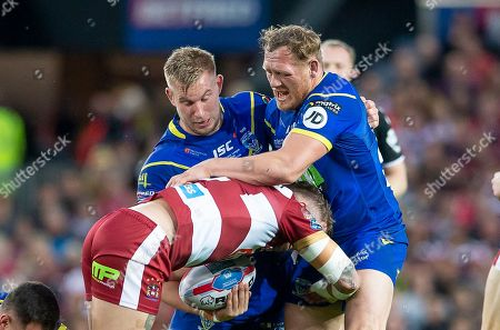 Wigan's Dominic Manfredi is tackled by Warrington's Mike Cooper & Ben Westwood.