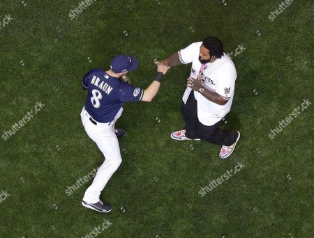 Stock Image of Prince Fielder has some with Milwaukee Brewers' Ryan Braun after throwing out the ceremonial first pitch before Game 2 of the National League Championship Series baseball game against the Los Angeles Dodgers, in Milwaukee