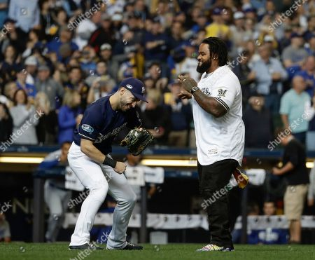 Stock Picture of Prince Fielder has fun with Milwaukee Brewers' Ryan Braun after throwing the ceremonial first pitch before Game 2 of the National League Championship Series baseball game against the Los Angeles Dodgers, in Milwaukee