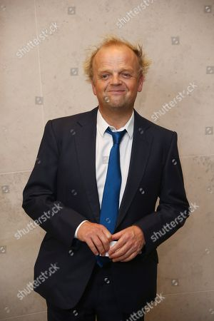 Toby Jones poses for photographers upon arrival at the The Academy of Motion Picture Arts and Sciences Reception in London during the London Film Festival