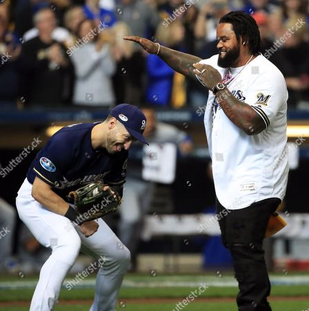 Stock Photo of Milwaukee Brewers player Ryan Braun (L) jokes with former player Prince Fielder (R) after he threw out the first pitch before game against the Los Angeles Dodgers for game two of the National League Championship Series at Miller Park in Milwaukee, Wisconsin, USA, 13 October 2018. The Brewers lead the best-of seven series and the winner will go on to face either the Boston Red Sox or the Houston Astros in the World Series.