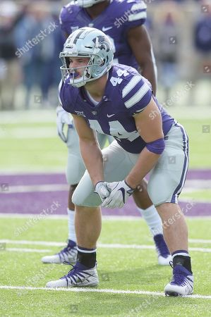 Kansas State Wildcats defensive end Kyle Alan Ball (44) at the line of scrimmage during the NCAA Football Game between the Oklahoma State Cowboys and the Kansas State Wildcats at Bill Snyder Family Stadium in Manhattan, Kansas
