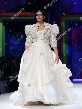 Bollywood actress Huma Qureshi presents a creation during the Rainbow theme fashion show to celebrate the decraminalization of the anti-gay sex law at the grand final of the Lotus Make-up India Fashion Week Spring-Summer 2019 in New Delhi, India, 13 October 2018. Models walked the runway wearing dresses based on the Rainbow theme, an emblem for the LGBTQ community to show solidarity. India's Supreme Court ruled on 06 September 2018, that gay sex is no longer a criminal offence. Five Supreme Court judges repealed a colonial-era law (section 377) and legalize gay sex between consenting adults.