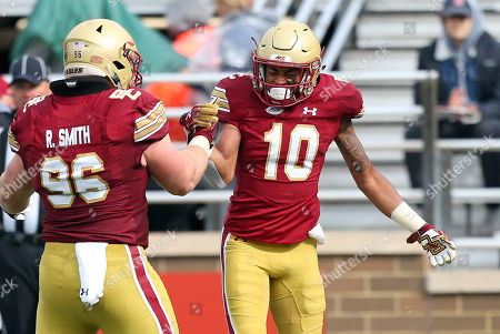 Chestnut Hill, MA, USA; Boston College Eagles defensive back Brandon Sebastian (10) and Boston College Eagles defensive tackle Ray Smith (96) celebrate during the NCAA football game between Louisville Cardinals and Boston College Eagles at Alumni Stadium. Boston College won 38-20
