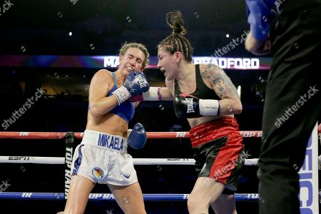 Vanessa Bradford, right, lands a punch on Mikaela Mayer, during their super featherweight NABF title boxing bout in Omaha, Neb., . Mikaela Mayer won the bout by unanimous decision