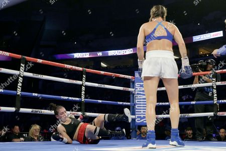 Mikaela Mayer, Vanessa Bradford. Mikaela Mayer looks at Vanessa Bradford after knocking her down during their super featherweight NABF title boxing bout in Omaha, Neb., . Mikaela Mayer won by unanimous decision