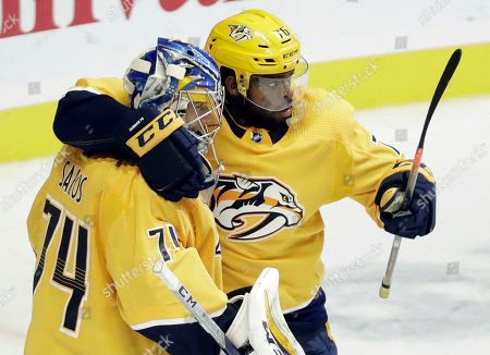 Juuse Saros, P K Subban. Nashville Predators defenseman P.K. Subban (76) congratulates goaltender Juuse Saros (74), of Finland, after the Predators defeated the New York Islanders 5-2 in an NHL hockey game, in Nashville, Tenn