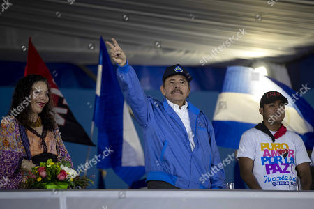 Nicaraguan President Daniel Ortega (C), vice president of Nicaragua, his wife Rosario Murillo (L), and Nicaraguan boxer Roman Gonzalez (R) participate in a public ceremony to celebrate the canonization of Salvadoran beatus Oscar Arnulfo Romero in Managua, Nicaragua, 13 October 2018. Romero was killed on 24 March 1980 by an armed right-wing squadron while he was officiating in the chapel of the Divina Providencia cancer hospital in San Salvador, in the days prior to the outbreak of the Salvadoran civil war (1980-1992), according to the Report of the Truth Commission.