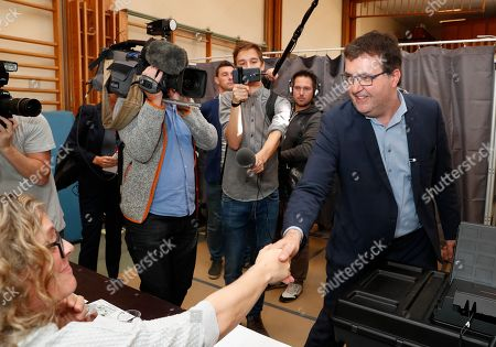 Stock Picture of Wouter Van Besien of the Groen (Green) party votes in the municipal election at a polling station in Borgerhout district, Antwerp, Belgium, 14 October 2018. Belgian citizens will vote on 14 October 2018, to elect members of the municipal council of their municipality.
