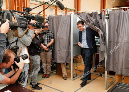 Wouter Van Besien of the Groen (Green) party votes in the municipal election at a polling station in Borgerhout district, Antwerp, Belgium, 14 October 2018. Belgian citizens will vote on 14 October 2018, to elect members of the municipal council of their municipality.