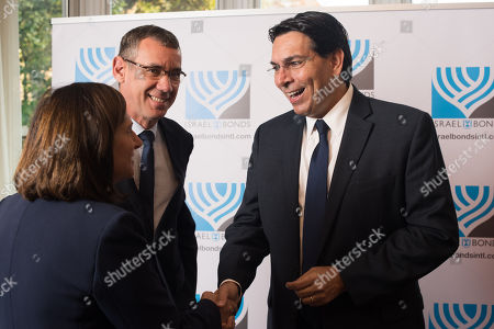 Stock Picture of Louise Jacobs Chair of UJIA with Ambassador Mark Regev and Ambassador Danny Danon.