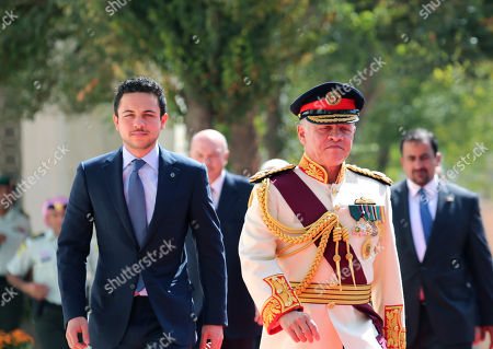 King Abdullah II of Jordan (2-R) walks with the Crown Prince of Jordan Al Hussein bin Abdullah (L) upon his arrival to give the Throne speech at the inauguration of the 18th parliament's third session, outside the Parliament building in Amman, Jordan, 14 October 2018. The Jordanian king gave his traditional annual throne speech to open the 18th Parliament's third ordinary session to guide the government with a working program for the coming phase.