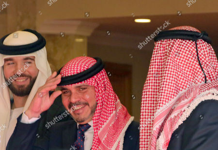 Stock Picture of Jordan's Prince Ali bin Hussein (C) gestures as him, Prince Hashim bin Hussei (L) and Prince Faisal bin Hussein (R), wait for the arrival of King Abdullah II of Jordan's for his Throne speech at the inauguration of the 18th parliament's third session in Amman, Jordan, 14 October 2018. The Jordanian king gave his traditional annual throne speech to open the 18th Parliament's third ordinary session to guide the government with a working program for the coming phase.