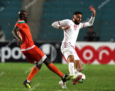 Stock Image of Tunisian player Moustapha Mohamed  (R) and Niger player  Fakhreddine Ben youssef  (L) fight for the ball during 2019 Africa Cup of Nations qualifier match between Tunisia and Niger at the Olympic Stadium of Rades in Tunis, Tunisia, 13 October 2018.