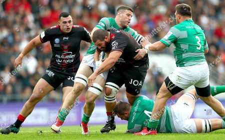 RC Toulon vs Newcastle Falcons. Newcastle's Mark Wilson, Will Witty and David Wilson tackle Marcel van der Merwe of Toulon