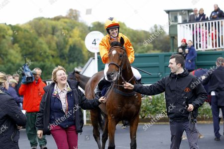Montestrel and Lizzie Kelly after victory in the Champion Hats Juvenile Hurdle at Chepstow with trainer/mother, Jane Williams [left].