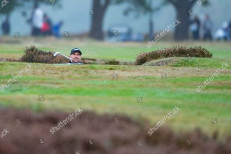 Trevor Immelman of South Africa sizing up a bunker shot during the British Masters 2018 at Walton Heath Golf Course, Walton On the Hill. Picture by Martin Cole
