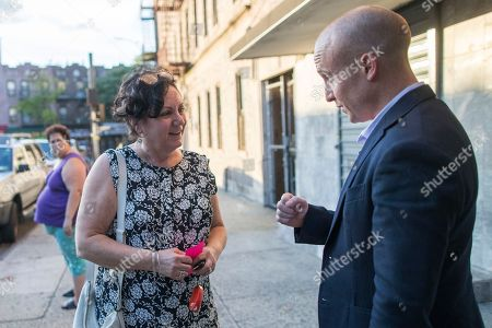 Democratic congressional candidate Max Rose talks with Annemarie Rossi while canvassing in the Bay Ridge neighborhood of the Brooklyn borough of New York. Rose will face Republican incumbent Dan Donovan in the 2018 mid-term elections. They are competing in a district that consists of Staten Island, the most conservative of New York City's five boroughs, plus a slice of Brooklyn