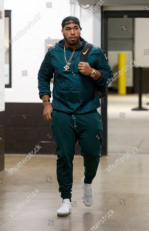 Cleveland Browns defensive lineman Carl Davis walks into the stadium before an NFL football game between the Los Angeles Chargers and the Cleveland Browns, in Cleveland