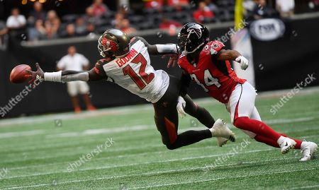 Tampa Bay Buccaneers wide receiver Chris Godwin (12) reaches as Atlanta Falcons wide receiver Justin Hardy (14) defends during the first half of an NFL football game, in Atlanta