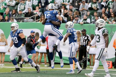 Indianapolis Colts quarterback Andrew Luck (12) leaps on tight end Erik Swoope after they connected for a touchdown during the second half of an NFL football game against the New York Jets, in East Rutherford, N.J