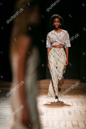 Portuguese model Isilda Moreira presents a creation by Toronto-based designer Andrew Coimbra during the 51st Lisbon Fashion Week, in Lisbon, Portugal, 14 October 2018. The event ends today.